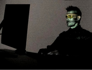 Computer user in dark room